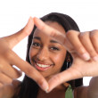 Beautiful black teenage girl fun hand frame sign — Stock Photo #7044584