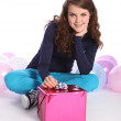 Party balloons and present for teenager girl — Stock Photo #7045408