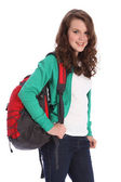 Happy teenage school girl with red backpack — Stock Photo