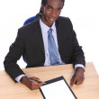 Young African American businessman at office desk — Stock Photo