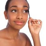 African American woman using mascara brush — Stock Photo #7091091