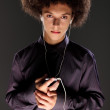 Big bushy afro hair teenager listening to music — Stock Photo