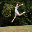Jump for joy beautiful girl in countryside leaping — Stock Photo