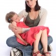 Mother holding sleeping daughter with love — Stock Photo