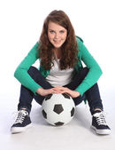 Teenage girl soccer player sits with football — Stock Photo