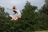 Beautiful sexy woman flying jump for fun success — Stock Photo
