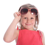 Six year old girl having fun with sunglasses — Stock Photo