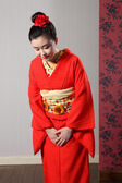 Bowing respect by Asian woman in Japanese kimono — Stock Photo