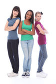 Three teenage girl friends black white and asian — Stock Photo