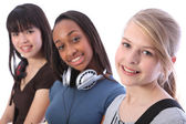 Blonde teenage student girl and ethnic friends — Stock Photo