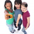 Happy mixed race girl friends fun taking pictures — Stockfoto