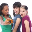 Teenage girls fun photography with digital camera — Stock Photo