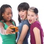 Teenage girls fun photography with digital camera — Stock Photo
