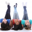 Upside down fun for three student girl friends — Stock Photo
