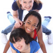 Three mixed race girl friends having fun together — Stock Photo