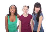 Ethnic teenage girl friends fun tongues out — Stock Photo