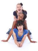 Happy multi ethnic girl friends human totem pole — Stock Photo