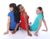 Trio teenage girls mixed races looking backwards — Stock Photo