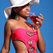 African american woman drinking cocktail in sun - Stock Photo