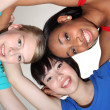 Happy group huddle by mixed race student girls — ストック写真