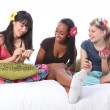 Stock Photo: Slumber party beautiful teenage girls laughing