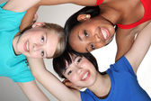 Happy group huddle by mixed race student girls — Stock Photo