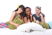 Pyjama party fun for teenage girls in bed at home — Stock Photo