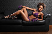 Leather and lingerie sexy african glamour model — Stock Photo