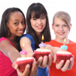 Birthday cakes for 3 mixed ethnic teenage girls — Stock Photo