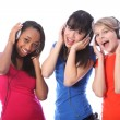 Teenage girls singing to music on mobile phones — Stockfoto #7256355