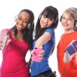 Smiling teenage girls fun with mobile phone music — Stock Photo