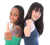 Team success for African and Japanese teenagers — Stock Photo