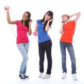 Teenage girls dancing fun to cell phone music — Stock Photo