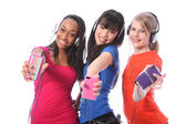 Smiling teenage girls fun with mobile phone music — Stock Photo