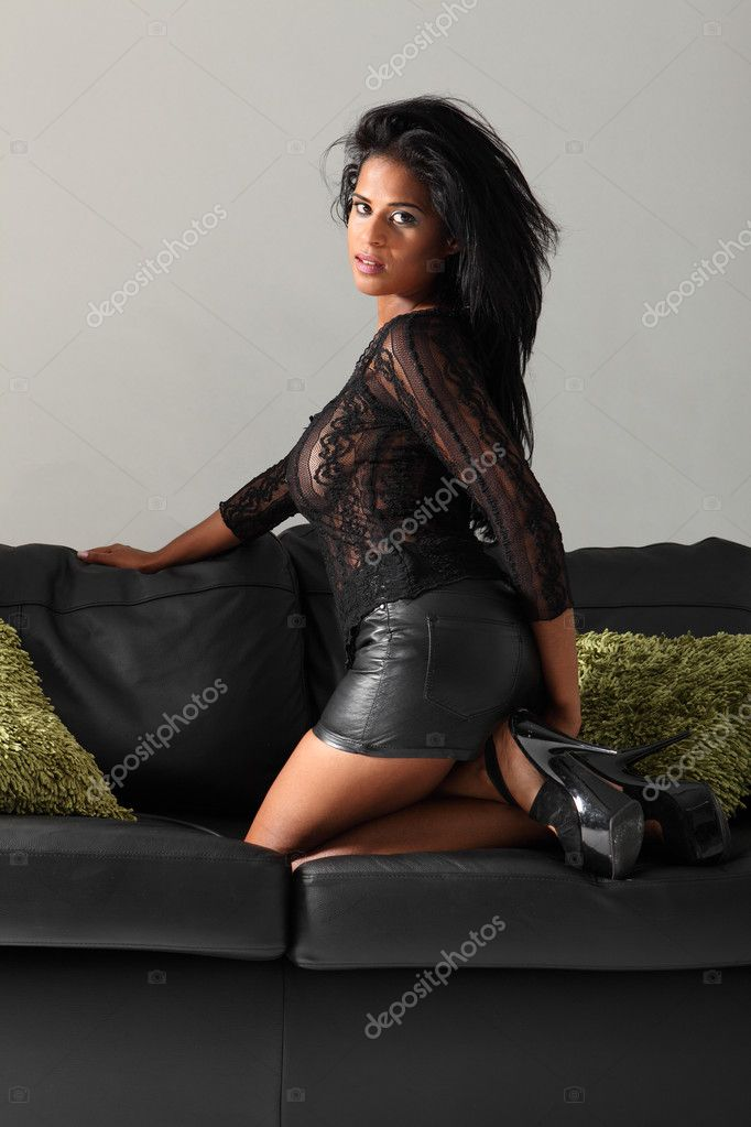Sexy African American Glamour Girl Leather Couch Stock