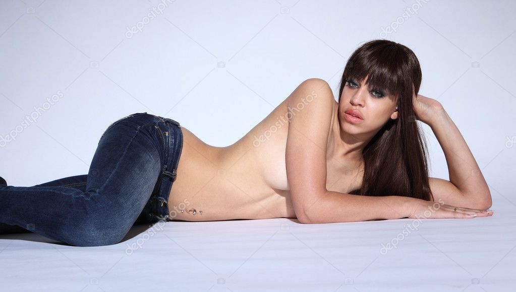 Lying on floor semi nude a young mixed race glamour model woman with long ...