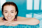 Smiling girl at the swimming pool — Stock Photo
