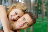 Happy teenage couple at the park — Stock Photo