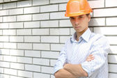 Worker near a white wall — Stock Photo