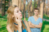 Offended girl and a boy at the background — Foto Stock