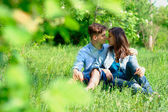 Happy young couple at the park — Stock Photo