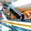 Golden escalators — Stock Photo #7347909