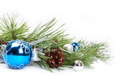 Blue ball and pine branch — Стоковое фото