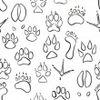 Animal paw seamless pattern — Stock Vector