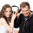 Man, girl, headphones — Stockfoto