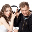 Man, girl, headphones - Stock Photo