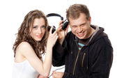 Man, girl, headphones — Stock Photo