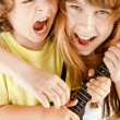 Kids playing guitar singing — Stock Photo