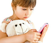 Little girl teddy bear phone — Stock Photo