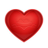 Red leather pillow as heart — Stockfoto